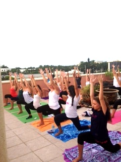 Lunge with Hands Up — Naples High School Varsity Cheerleading Team Private Yoga Event | Purely You Spa
