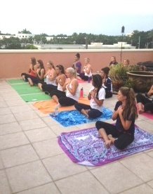 Smile Across Heart — Naples High School Varsity Cheerleading Team Private Yoga Event | Purely You Spa