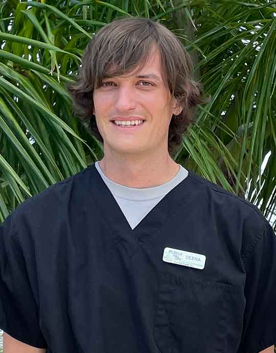 Derek (Deena), Spa Lead Therapist, Dually Licensed in Massage and Skin at Purely You Spa in Naples, Florida | Certified Organic Day Spa